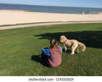 woman enjoying view with goldendoodle