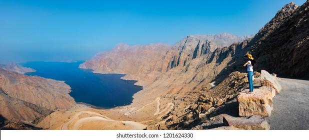 Woman enjoying view over Fjord Khor Najd in Musandam Oman