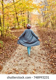 Woman enjoying walk in autumn forest