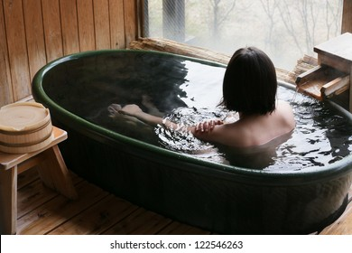 Woman enjoys bath at hot springs in Japan