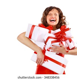 Woman enjoys boxes with gifts, which she holds in her hands
