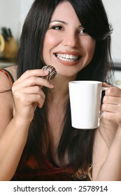 A woman enjoys coffee and chocolate