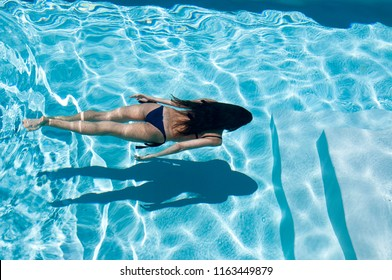 woman enjoys her holidays in the water pool