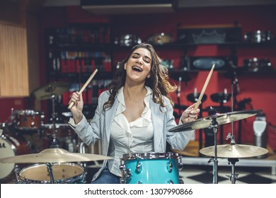 Woman enjoys playing musical instruments