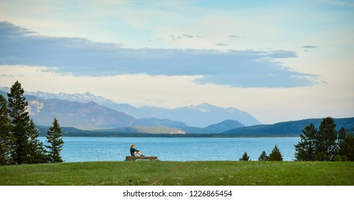 Woman enjoys the Rocky Mountain view and Columbia Lake in Canada