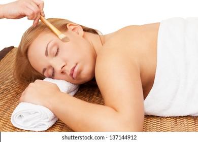 Woman enjoys spa with cosmestics