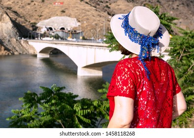 Woman enjoys the view to the architecture of the komurhan bridge in Malatya, turkey