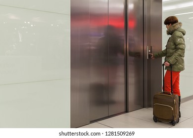 the woman enters the elevator in the business center