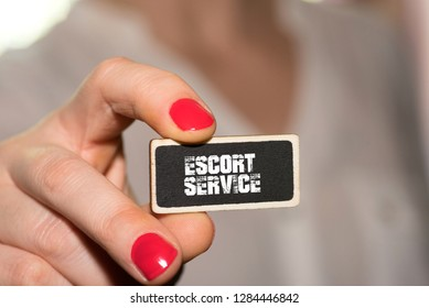 A woman and escort service card
