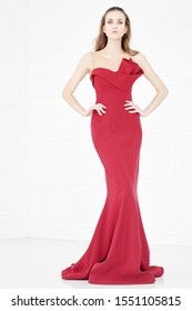 Woman in evening Red Dress, Beautiful Fashion Model on white background.