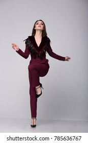 Woman in evening suit, fashion, style.