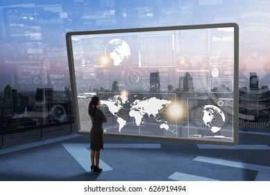 Woman examine high tech screen, next generation of technology
