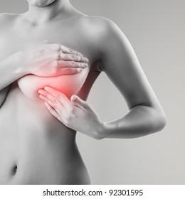 woman examining breast mastopathy or cancer