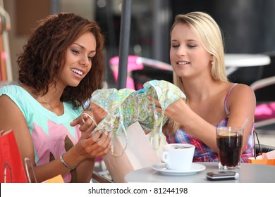 Woman examining their purchases