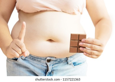 Woman with excessive weight holding chocolate in hand. Girl with obesity on white background.