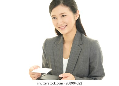The woman exchanges the business cards