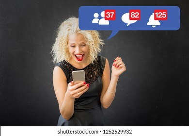 Woman excited about activity on social media