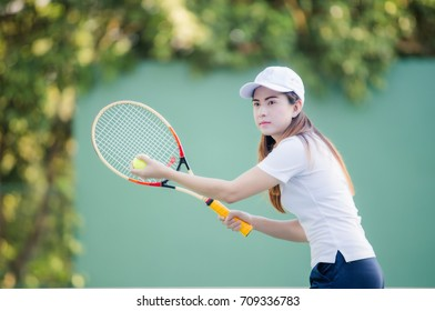 Woman exercise:  portrait of young beautiful woman Asian playing tennis.Young woman Asian playing tennis
