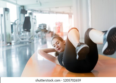 Woman exercise sit-up workout building sixpack abs at fitness gym training for healthy lifestyle strong on the floor sport people concept.