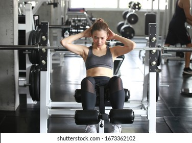 Woman exercise workout in gym , Athlete builder muscles lifestyle.fitness breaking relax holding apple fruit after training sport with dumbbell and protein shake bottle healthy lifestyle bodybuilding