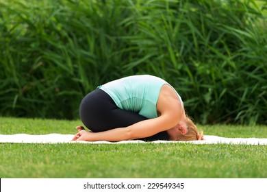 Woman exercise yoga asana child pose