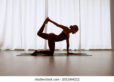 A woman exercises in quadruped pose