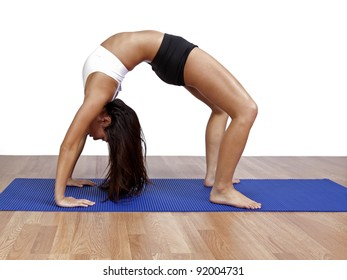 Woman exercising and arching her back