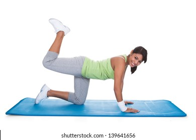 Woman Exercising Buttocks On Fitness Matt Isolated On White