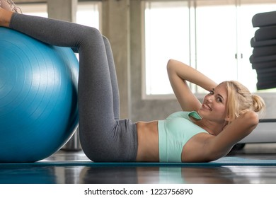 Woman exercising with fitball and training pilates.