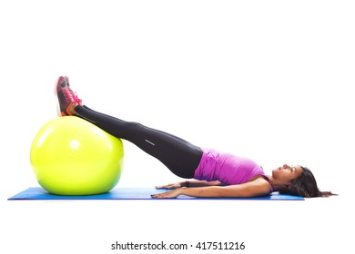 Woman exercising with a fitness ball