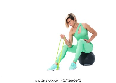 Woman exercising fitness resistance bands in studio silhouette isolated on white background.