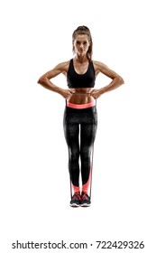 Woman exercising fitness resistance bands in studio silhouette isolated on white background
