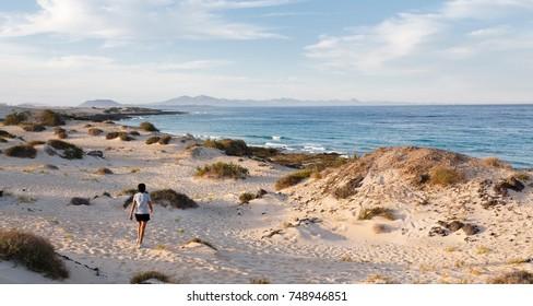 Woman exercising outdoors on a beach in Fuerteventura