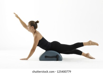 Woman exercising Pilates