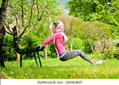 Woman exercising stretching in a Park