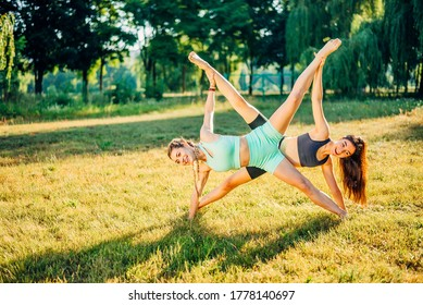 Woman exercising in summer park