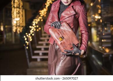 Woman with expensive crocodile leather handbag