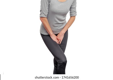 woman experiences pain in the perineum. Hands pressed to vagina, lower abdomen. Urinary incontinence. Gynecological problems. Woman's health