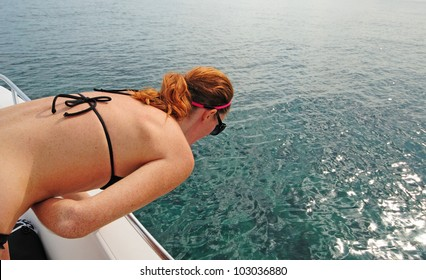 Woman experiencing motion sickness while on a boat