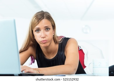 woman expressing her big boredom about a data entry or some kind of repetitive task on her pc