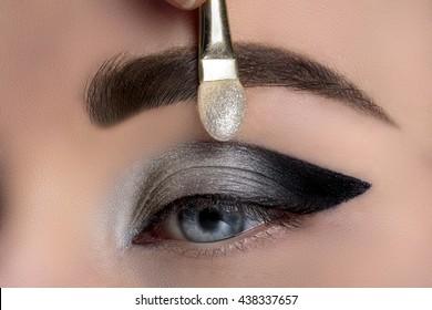 Woman eye with beautiful makeup closeup