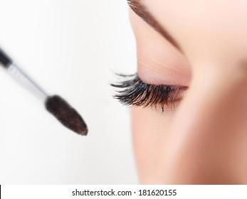 Woman eye with beautiful makeup and long eyelashes. Mascara Brush. High quality image.