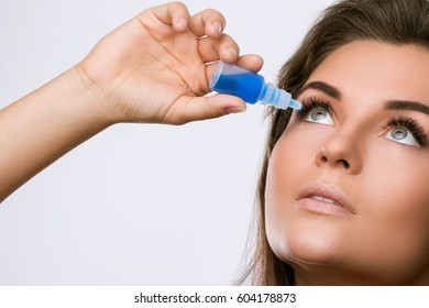 Woman and eye drops