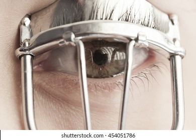 Woman Eye with Eyelash Curler