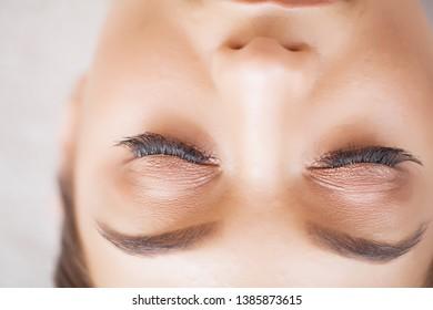 ca47bd187c3 Woman Eye with Long Eyelashes. Beautiful Young Woman During Eyelash  Extension