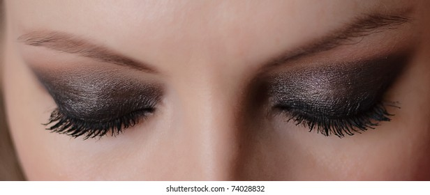 Woman eyes with long eyelashes and makeup