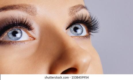 Woman eyes with long eyelashes and smokey eyes make-up. Eyelash extensions, makeup, cosmetics, beauty. Close up, macro