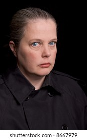 Woman with eyes open over a black background