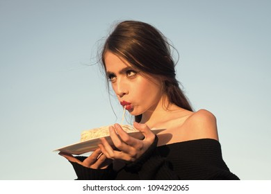 Woman face beauty. caucasian woman eating delicious on blue sky background