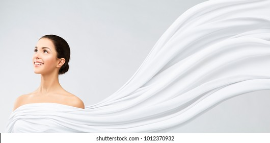Woman Face Beauty Portrait, Young Happy Girl in White Flowing Waving Fabric, Beautiful Model Looking Side, Makeup and Skin Treatment Concept